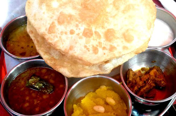 breakfast Pakistani Halwa Puri with Chanay nashta